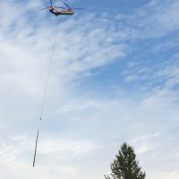helicopter placing large wood